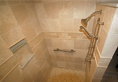 Linear Tile Breaks Up A Pattern Of 12x12 Inch And 3x6 Inch Wall Tile And  Frames A Wall Niche On The Interior Of This Walk In Shower.